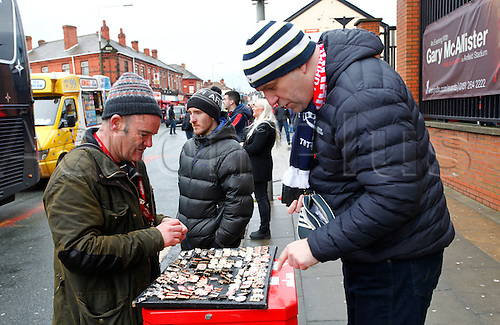 02.04.2016. Anfield, Liverpool, England. Barclays Premier League. Liverpool versus Tottenham Hotspur.  A Liverpool fan from the Czech Republic buys badges before today's game.