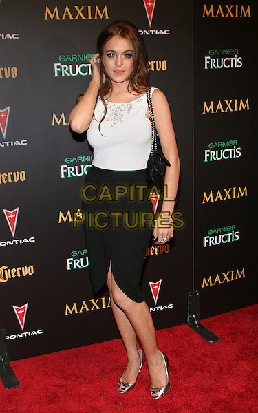 LINDSAY LOHAN.At Maxim Hot List Party at Buddah Bar, New York, NY, USA..May 17th, 2006.Photo: Jackson Lee/Admedia/Capital Pictures.Ref: JL/ADM.full length black skirt white top dress purse bag silver peep toe shoes.www.capitalpictures.com.sales@capitalpictures.com.© Capital Pictures.