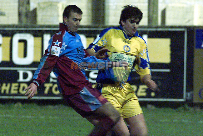 Drogheda United's Stewart Reynolds and Monaghan's Mick Scully battle it out as the sides drew 1-1..pic: Newsfile