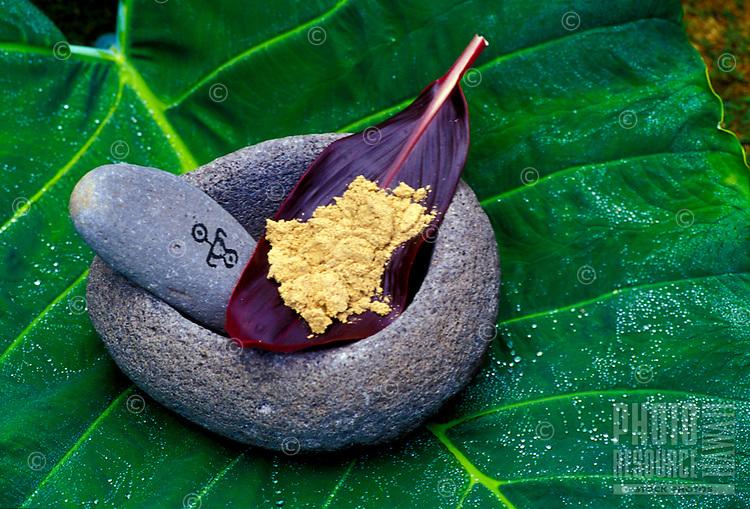 Ground Awa  (kava) powder on red ti leaf in Hawaiian stone bowl