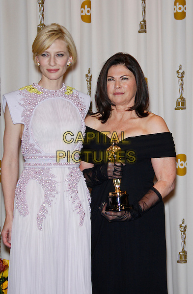 CATE BLANCHETT, COLLEEN ATWOOD.Best Costume Design.83rd Annual Academy Awards - Oscars.Kodak Theatre, Hollywood, CA, USA..February 27th, 2011 .oscars press room half 3/4 length white shoulder pads pale pink yellow beaded dress black .CAP/PE.©Peter Eden/Capital Pictures.