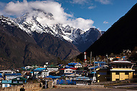 The village of Lukla is the start of the trek to Everest Base Camp in the Khumbu Valley of Nepal.  Seen from the tarmac of the Lukla Airport, dubbed the most dangerous airport in the world by the National Geographic channel.