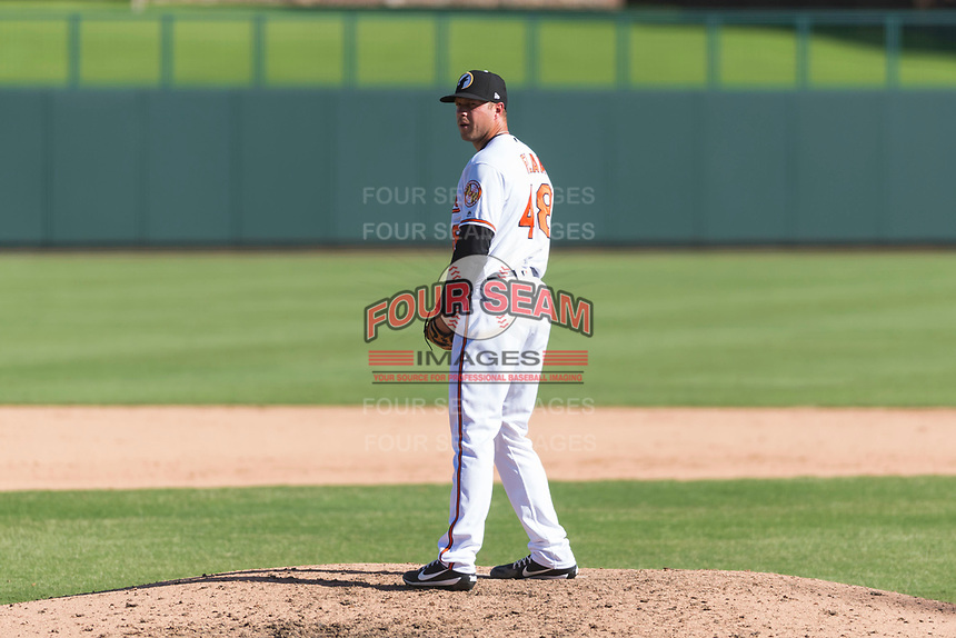 Glendale Desert Dogs relief pitcher Jay Flaa (48), of the Baltimore Orioles organization, gets ready to deliver a pitch during an Arizona Fall League game against the Mesa Solar Sox at Camelback Ranch on October 15, 2018 in Glendale, Arizona. Mesa defeated Glendale 8-0. (Zachary Lucy/Four Seam Images)