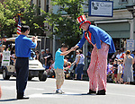 "A young onlooker, selected for an individual greeting by ""Uncle Sam"" depicted by, David Cardall, 70, of Saugerties, bows to the Iconic figure, during the Independence Day Parade, in Saugerties, NY on Thursday, July 4, 2013. Photo by Jim Peppler. Copyright Jim Peppler 2013 all rights reserved."