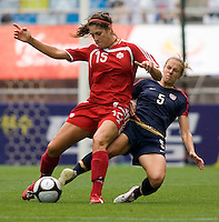USWNT midfielder (5) Lindsay Tarpley slides into Canada's (15) Kara Lang during the finals of the Peace Queen Cup.  The USWNT defeated Canada, 1-0, at Suwon World Cup Stadium in Suwon, South Korea.
