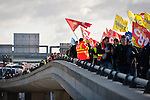 © Hughes Léglise-Bataille/Wostok Press.France, Roissy.20.10.2010.Plusieurs centaines de personnes ont manifeste a l'aeroport Charles-de-Gaulle a Roissy le 20/10/2010 contre la reforme des retraites, perturbant l'acces au terminal 2. Quelques heurts se sont produits avec les forces de l'ordre empechant le blocage des voies...Hundreds of people demonstrated at Charles-de-Gaulle airport in Roissy on October 20, 2010 against the pensions reform, disturbing the access to the terminal 2. A few clashes occurred with the police trying to prevent the blockade of the access roads.
