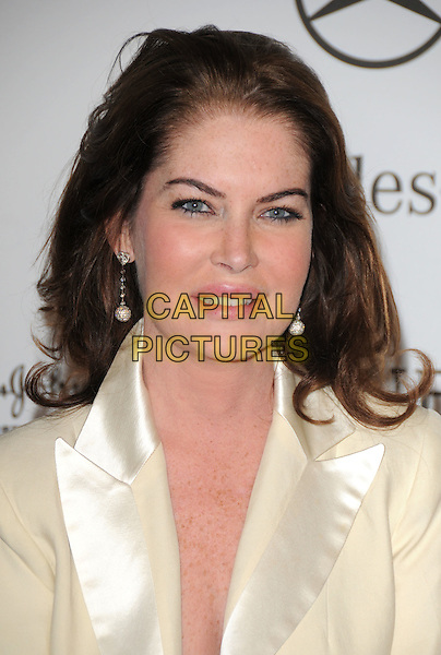 LARA FLYNN BOYLE .attends The 30th Anniversary Carousel of Hope Ball Presented by Mercedes-Benz held at The Beverly Hilton Hotel in Beverly Hills, California, USA,.October 25th 2008..portrait headshot pale yellow cream jacket heart dangly earrings .CAP/DVS.©Debbie VanStory/Capital Pictures