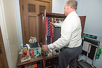 "United States Representative Dan Donovan (Republican of New York) selects a tie in his ""bedroom"" within his Capitol Hill office in Washington, DC on Thursday, March 8, 2018. Photo Credit: Ron Sachs/CNP/AdMedia"