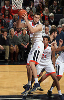 Virginia center Mike Tobey (10) gets the rebound during the game Tuesday, Jan. 12, 2016 in Charlottesville, Va. Virginia defeated Miami 66-58. Photo/Andrew Shurtleff