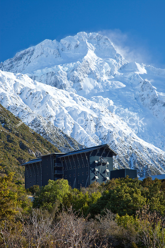 Snow covered Mount Sefton provides  a spectacular backdrop to the Hermitage Hotel at Aoraki / Mt Cook National Park