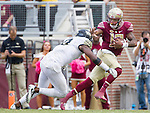Florida State quarterback Deondre Francois stiff arms Wake Forest linebacker Marquel Lee as he scrambles in the second half of an NCAA college football game in Tallahassee, Fla., Saturday, Oct. 15, 2016. Florida State defeated Wake Forest 17-6. (AP Photo/Mark Wallheiser)