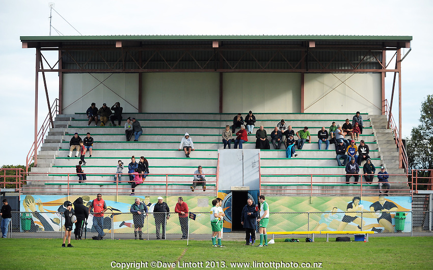 Fans watch from the grandstand during the Manawatu Club Rugby match between FOB-Oroua and Kia Toa at Johnson Park, Feilding, New Zealand on Saturday, 20 April 2013. Photo: Dave Lintott / lintottphoto.co.nz
