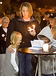 Halle Noel, l to r, Diana Noel, and Sawyer Novel prays during a light prayer vigil at the Champion's Centre in Tacoma WA., for family members, friends and law enforcement officers for four Lakewood Police officers killed at a Lakewood coffee shop on Sunday, Nov. 29, 2009.  At about 8:00 a.m. Sunday morning, a gunman walked into the Forza Coffee shop and while the four police officers were having coffee before their shift started, he opened fire, killing all four law enforcement officers.  The Noels' knew the police officers killed..Jim Bryant Photo. ©2010. ALL RIGHTS RESERVED.