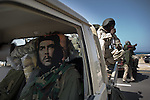 © Remi OCHLIK/IP3 - Bin Jawaad March 27, 2011 - Libyan fighters celebrate as they just took back the city of Bin Jawaad without fighting, they found the city empty from the loyalist Khadafi forces - New check point outside Bin Jawaad 130 km away from Syrte
