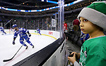 SIOUX FALLS, SD - MARCH 23: Four old Jayden Persons from Tea, SD, holds a puck that just popped out of the rink while watching Air Force warm up prior to the game between St. Cloud State University and Air Force at the 2018 West Region Men's NCAA DI Hockey Tournament at the Denny Sanford Premier Center in Sioux Falls, SD. (Photo by Dave Eggen/Inertia)