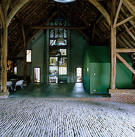 View down the length of the vast cathedral barn towards the modern extension
