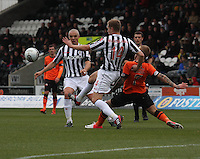 Marc McAusland clears under pressure from Johnny Russell as Jim Goodwin watches in the St Mirren v Dundee United Clydesdale Bank Scottish Premier League match played at St Mirren Park, Paisley on 27.10.12.