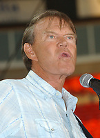 "08 August 2017 - Various - Glen Campbell, the voice behind 21 Top 40 hits including ""Rhinestone Cowboy,"" ""Wichita Lineman"" and ""By the Time I Get to Phoenix,"" died Tuesday. He was 81. During a career that spanned six decades, Campbell sold over 45 million records. In 1968, he outsold the Beatles. Campbell was married four times, and has five sons and three daughters. In the early 1980s, while battling alcoholism and cocaine addiction, Campbell made tabloid headlines with a 15-month, high-profile relationship with country singer Tanya Tucker, who was 22 years his junior. In 1981, he became a born-again Christian and in 1982 he married Kimberly Woollen, a Radio City Music Hall Rockette. In 2003, he was arrested for a hit-and-run, an incident that ended with him allegedly kneeing a police officer in the thigh right before he was released. Campbell pleaded guilty to extreme drunken driving and leaving the scene of an accident, and spent 10 days in jail. In 2011, Campbell, then 75, revealed that he was diagnosed with Alzheimer's disease. In June of that year, he announced he was retiring from music due to the disease. He released his final album of original music Ghost and embarked on a farewell tour with three of his children backing him. File Photo: June 13, 2004; Nashville, TN, USA; Singer GLEN CAMPBELL during the 2004  CMA Music Festival held at the Coliseum. Glen Campbell, who pleaded guilty last month to extreme drunken driving and leaving the scene of an accident, had his sentence delayed so he could perform Sunday at the CMA Music Festival. Photo Credit: Photo: Laura Farr/AdMedia"