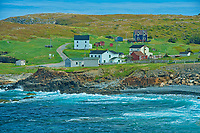 Rocky shoreline, houses and the Atlantic Ocean on the Bonavista Peninsula.<br />
