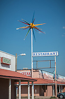 The El Comedor de Anayas Resturant originally opened in 1952 and the Roto-Sphere sign was installed in the 1960's.  The sign was restored in 2002 as one of 9 Route 66 signs with federal grant money.<br /> <br /> Roto-Sphere signs are perhaps the biggest and most dramatic neon signs ever mass-produced. They were created and produced by Warren Milks from 1960-1971. Milks made approximately 234 of them and only about 17 of them are left. Of these, only seven are fully operational.