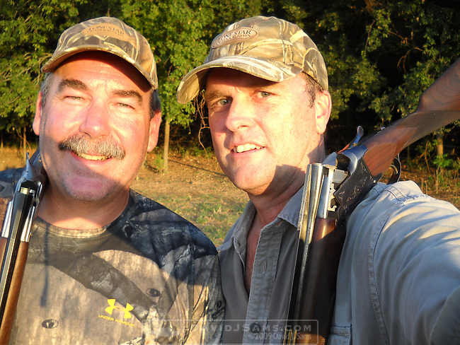 DOVE HUNTING.Opening day hunt near Waco Texas.David Sweet and Moose, black lab.hot weather hunting cooling down dog