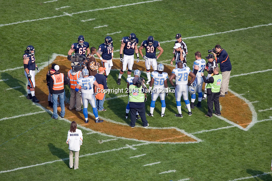 CHICAGO - NOVEMBER 2: The captains of the Chicago Bears and the Detroit Lions meet at midfield for the coin toss prior to the game at Soldier Field on November 2, 2008 in Chicago, Illinois. The Bears defeated the Lions 27-23. (Photo by David Stluka)