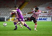 Lincoln City's Bruno Andrade vies for possession with  Carlisle United's Jack Sowerby<br /> <br /> Photographer Andrew Vaughan/CameraSport<br /> <br /> The Emirates FA Cup Second Round - Lincoln City v Carlisle United - Saturday 1st December 2018 - Sincil Bank - Lincoln<br />  <br /> World Copyright © 2018 CameraSport. All rights reserved. 43 Linden Ave. Countesthorpe. Leicester. England. LE8 5PG - Tel: +44 (0) 116 277 4147 - admin@camerasport.com - www.camerasport.com
