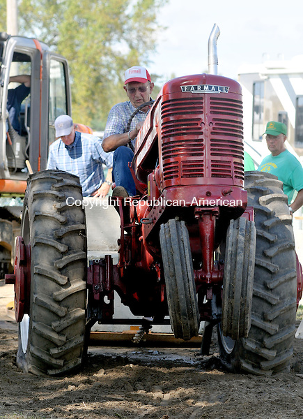 BETHLEHEM, CT, 10 SEPTEMBER 2011-091011JS04--Arnold Tonn of Harwinton tries his best to pull 9200 lbs. in ths 1950 Farmall M tractor during the tractor pull competition during the Bethlehem Fair Saturday at the Bethlehem Fairgrounds. The fair continues through today. <br /> Jim Shannon Republican-American