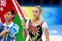 August 22, 2008; Beijing, China; Rhythmic gymnast Inna Zhukova of Belarus carries flag during march-in ceremony on way to winning silver in the All-Around final at 2008 Beijing Olympics..(©) Copyright 2008 Tom Theobald