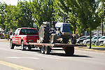 Ford truck towing flatbed trailer with tractor