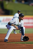 Gwinnett Stripers third baseman Johan Camargo (17) on defense against the Scranton/Wilkes-Barre RailRiders at Coolray Field on August 17, 2019 in Lawrenceville, Georgia. The Stripers defeated the RailRiders 8-7 in eleven innings. (Brian Westerholt/Four Seam Images)