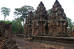 Angkorian temple Banteay Srei (late 10th century) 967.<br /> All three sanctuary towers have carvings on the western side with pediments showing Varuna, gaurdian god of the west riding on geese.The lintels show Ravana abducting Sita.<br /> The central sanctuary and the southern sanctuary were dedicated to Shiva and the northern sanctuary was dedicated to Vishnu.<br /> Banteay Srei temple is situated 20km north of Angkor, built during the reign of Rajendravarman by Yajnavaraha, one of his counsellors. In antiquity Isvarapura was a small city that grew up around the temple. Banteay Srei was dedicated to the worship of Shiva, the foundation stele describes the consecration of the linga Tribhuvanamahesvara (Lord of the three worlds) in 967.