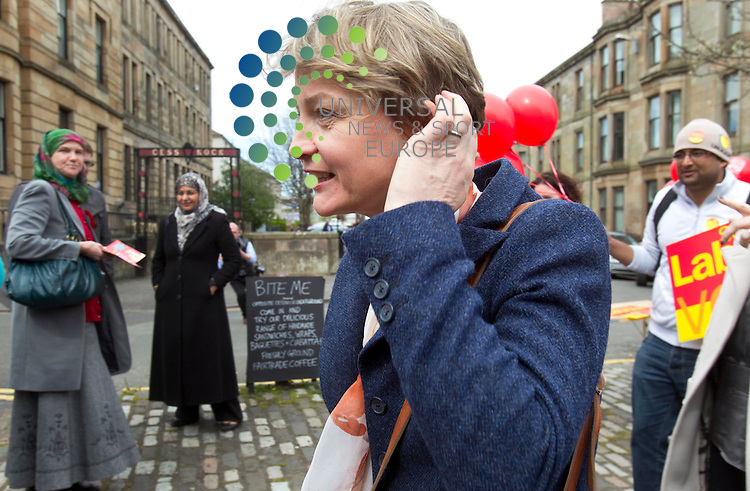Yvette cooper MP (Shadow home secretary) helps out on the local scottish vote that will be held on thursday. Yvette cooper on the campaign trail in Ibrox, Glasgow as she passes a sign saying bite me..Picture: Maurice McDonald/Universal News And Sport (Europe). 1 May 2012. www.unpixs.com.