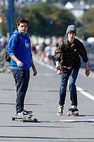 Pictured: Skateboarders enjoy the sunny weather at Mumbles, near Swansea, Wales, UK. Thursday 19 September 2019