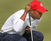 28 SEP 12  Tiger Woods looks over a putt at Fridays foresome and four ball matches  at The 39th Ryder Cup at The Medinah Country Club in Medinah, Illinois.