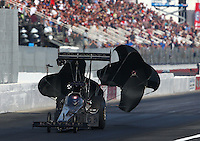 Feb 7, 2015; Pomona, CA, USA; NHRA top fuel driver Shawn Langdon runs the quickest time in history with a 3.700 during qualifying for the Winternationals at Auto Club Raceway at Pomona. Mandatory Credit: Mark J. Rebilas-USA TODAY Sports