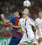 Barcelona's Lionel Messi and AC Milan's Ignazio Abate during Champions League match on september 13th 2011...Photo: Cesar Cebolla / ALFAQUI