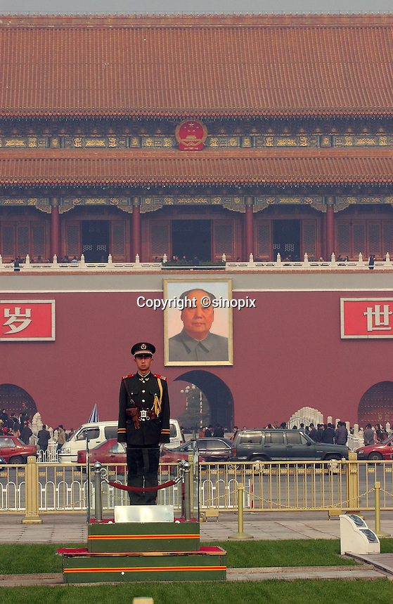People's Liberation Army Officers in front of Chairman Mao portrait at the Tiananmen Square, Beijing, China..04-nov-04