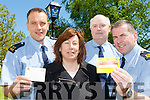 Show them the Card is the message from Killarney Gardai for anyone turning up at your doorstep unannounced lauching the card on Wednesday were l-r: Garda John Guest,  Garda Brendan Cronin, and  Garda Eddie Walsh with Cathy Courtney Home Instead Senior care