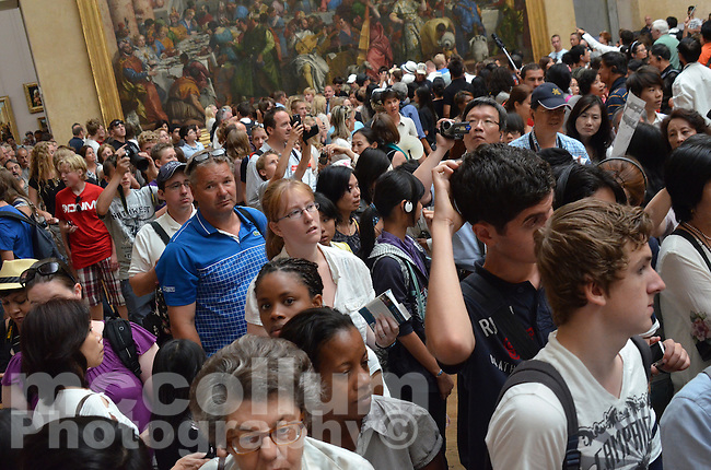 Michael McCollum.7/4/11.Large crowd of tourists wanting to see the Mona Lisa, (Mona Lisa also known as La Gioconda or La Joconde, or Portrait of Lisa Gherardini, wife of Francesco del Giocondo is a portrait by the Florentine artist Leonardo da Vinci.)in the Louvre Museum Paris, France