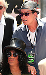 LOS ANGELES - JUL 10: Charlie Sheen, Slash at a ceremony where Slash is honored with the 2,473rd Star on the Hollywood Walk of Fame on July 10, 2012 in Los Angeles, California