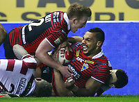 PICTURE BY CHRIS MANGNALL /SWPIX.COM...Rugby League - Super League  - Wigan Warriors v Warrington Wolves - DW Stadium, Wigan, England  - 23/03/12... Warrington's 1st Try scored by Ryan Atkins helped by Chris Riley tackled by Wigan's Darrell Goulding and Josh Charnley