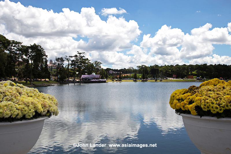 Xuan Huong Lake in Dalat - The hill station town of Dalat considers Xuan Huong Lake as its center. This man made lake was once the site  where original indigenous people of Langbian Highland lived before Dalat was developed by the French. In 1919 and 1923, two dams were formed on a branch of the Cam Ly River to create two small lakes.  At that time, the French named it Grand Lac but in 1953 it was renamed Xuan Huong Lake after Ho Xuan Huong, a famous Vietnamese poet.