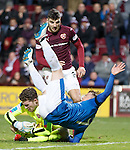Joe Garner collides with keeper Jack Hamilton