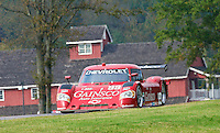 The #99 Chevrolet Riley of Alex Gurney and Jon Fogarty races past a red building during the Grand-Am Rolex Series test at Virginia International Raceway, Alton, VA , October 2010. (Photo by Brian Cleary/www.bcpix.com)