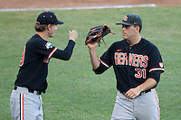 Oregon State pitcher Matt Boyd (31) is greeted by teammate Max Engelbrekt (19) after pitching an inning against the Indiana Hoosiers during Game 9 of the 2013 Men's College World Series  on June 19, 2013 at TD Ameritrade Park in Omaha, Nebraska. The Beavers defeated the Hoosiers 1-0, eliminating Indiana from the tournament. (Andrew Woolley/Four Seam Images)