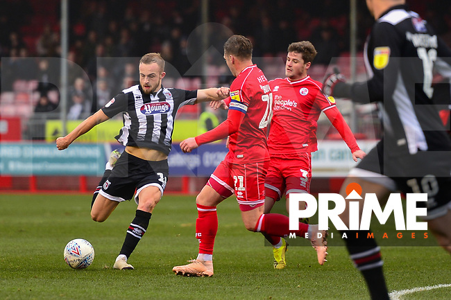 Charles Vernam in action against Dannie Bulman during the Sky Bet League 2 match between Crawley Town and Grimsby Town at The People's Pension Stadium, Crawley, England on 25 January 2020. Photo by Lee Blease.