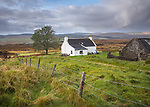Isle of Skye, Scotland:<br /> Old croft house under clearing sky near Portree