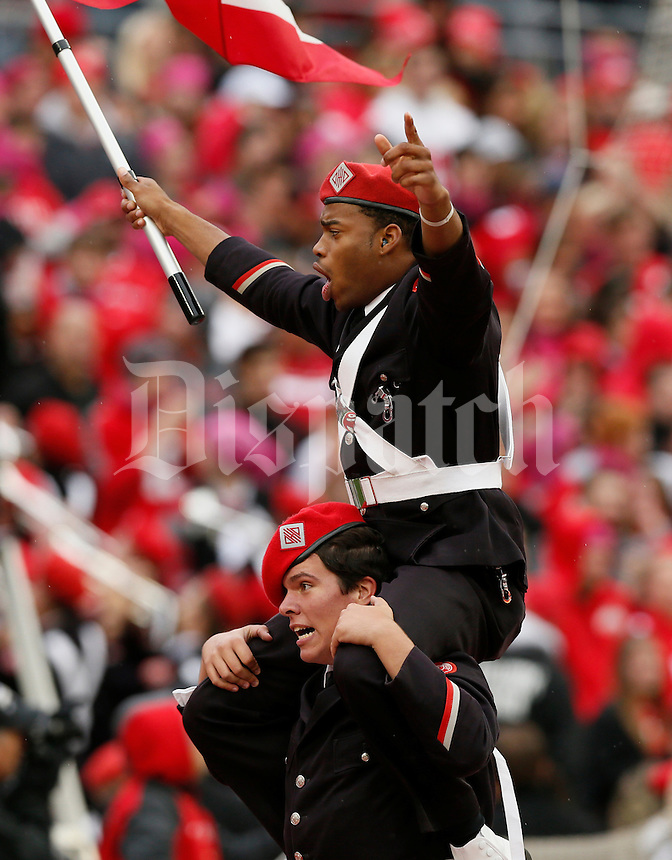 Members of the Ohio State University Marching Band celebrate a touchdown during Saturday's NCAA Division I football game against the Rutgers Scarlet Knights at Ohio Stadium in Columbus on Oct. 18, 2014. (Dispatch Photo by Barbara J. Perenic)