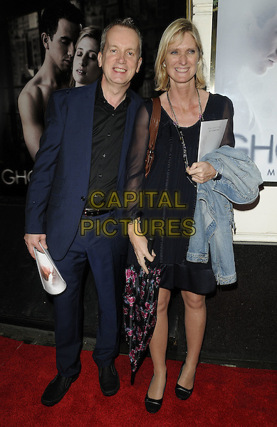"FRANK SKINNER & guest.""Ghost The Musical"" press night, Piccadilly Theatre, Denman St., London, England..July 19th, 2011.full length black suit blue dress.CAP/CAN.©Can Nguyen/Capital Pictures."